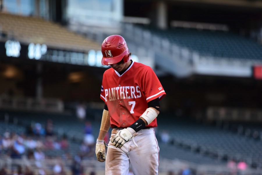 Angelo Altavilla exits the field at Target Field in the state championship