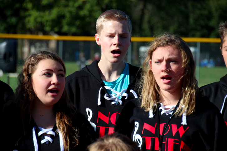 Now and Then of Lakeville North High School sang the National Anthem