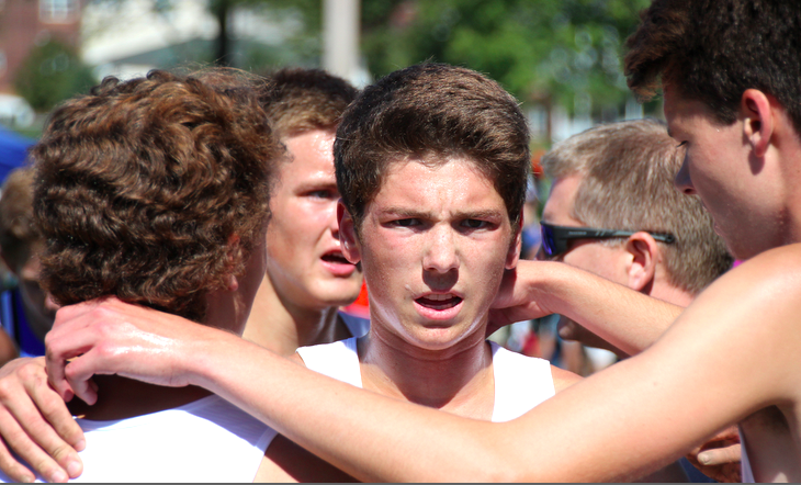 Three of Lakeville North's top five runners huddle up after they finish the race