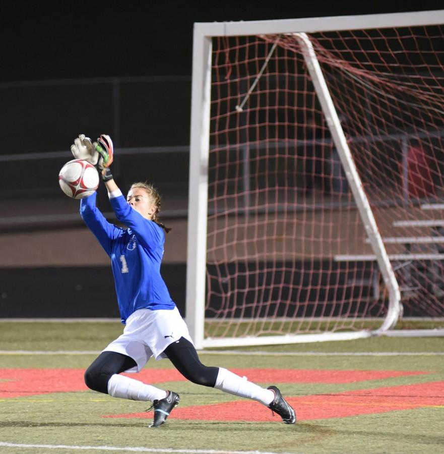 Lock makes a save in the regular season. Photo by Renee Finne