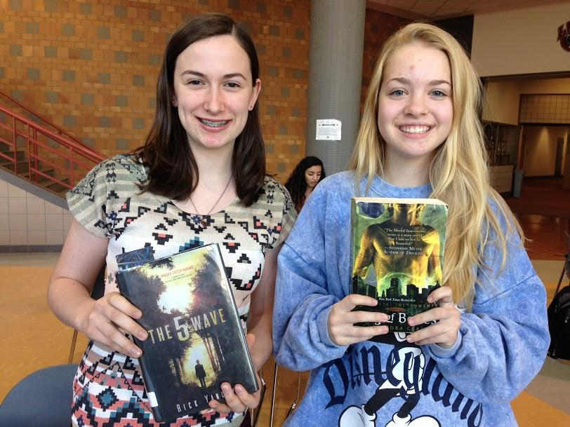 Maya and Mikaela, freshmen, hold The 5th Wave and Mortal Instruments