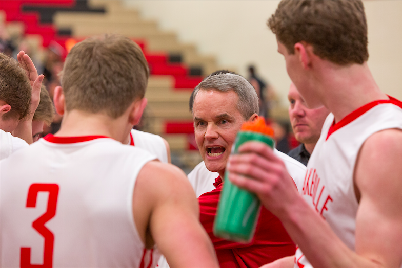 Oxton instructs his players during a timeout of the game that became his 500th victory. Photo by Sue Nelson