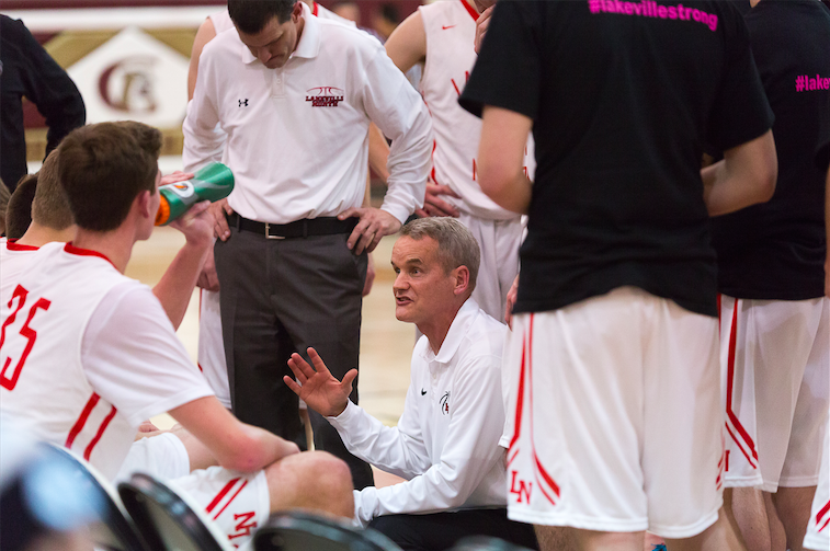 Oxton coaches the Panthers during a timeout in the regular season