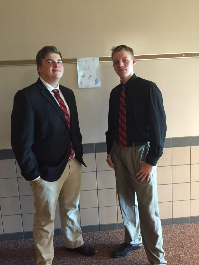 Juniors Drake Olsen and Cole Brenno model their Greater Good ties