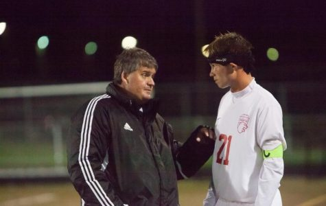 Seamus Tritchler coaches captain Olaf Morkeberg at halftime.