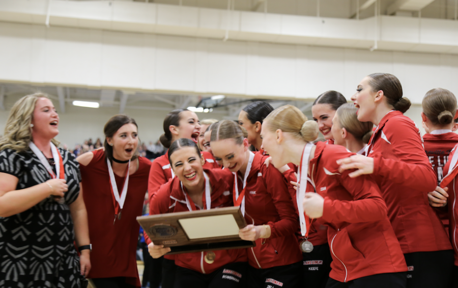 Seniors+and+coaches+receiving+their+Section%27s+plaque.++Photo+by+Katie+Harff.
