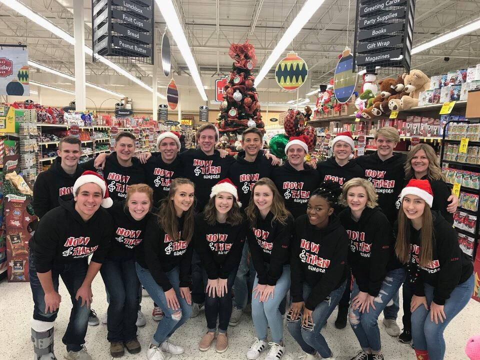 Lakeville North's choir, Now & Then help bag groceries at a local Cub Foods