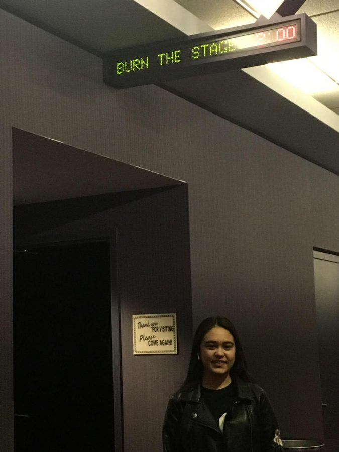 Alyssa Cheng standing outside the movie theater, awaiting the showing of Burn The Stage.