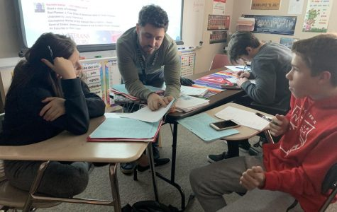 In an effort to understand class a bit better, Mr. Csargo, helps his students during PASS.